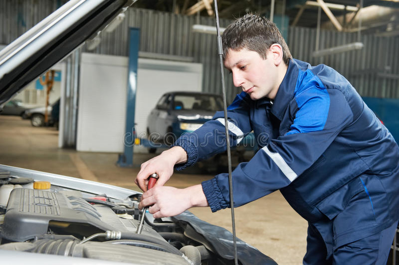Download Auto Mechanic At Work With Wrench Stock Image - Image: 24253499