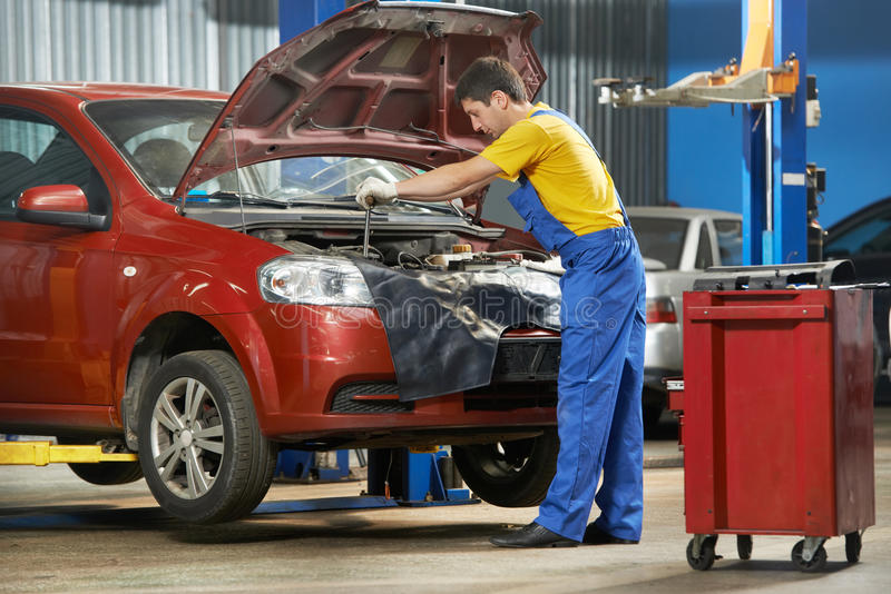 Auto mechanic at work with wrench royalty free stock photography