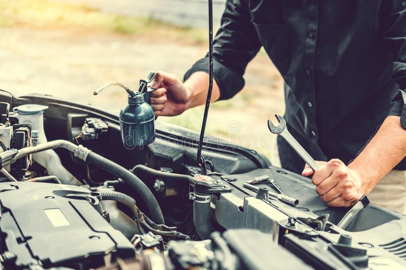 Auto mechanic working in garage Technician Hands of car mechanic working in auto repair Service and Maintenance car check stock image