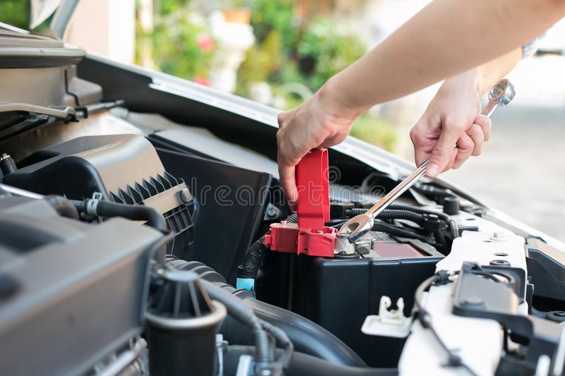 Auto mechanic working at outdoor. Repair service concept royalty free stock image