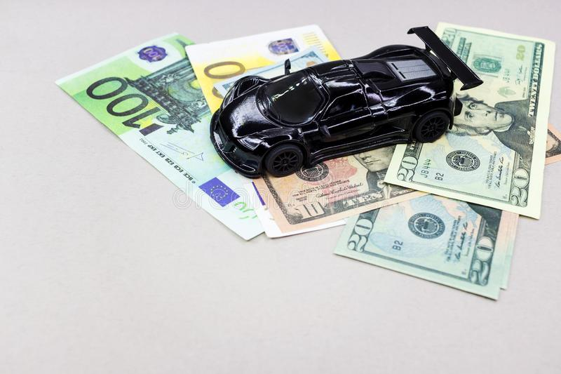 Auto money, background and texture for finance. Miniature car model and Financial statement with coins. Finance and car loan, saving money for a car or material royalty free stock photo