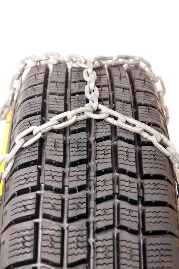 Auto pneu e correntes imagem de stock royalty free