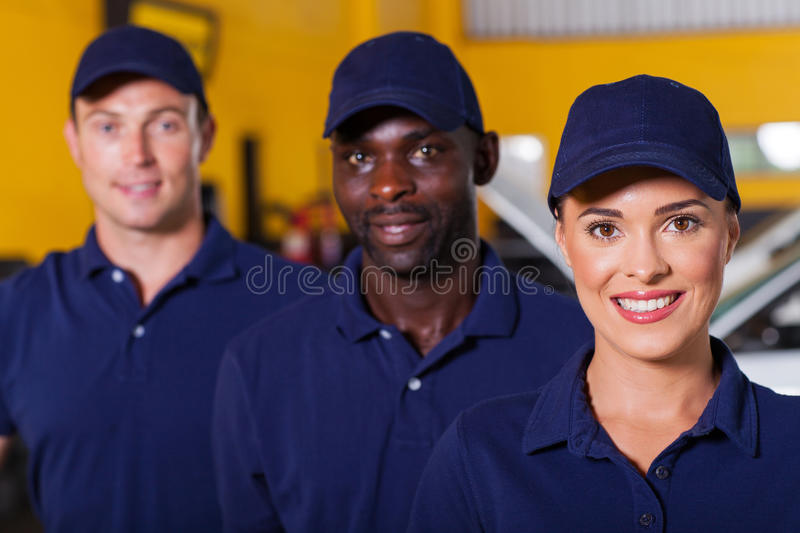 Auto repair employees. Group of auto repair shop employees stock photo