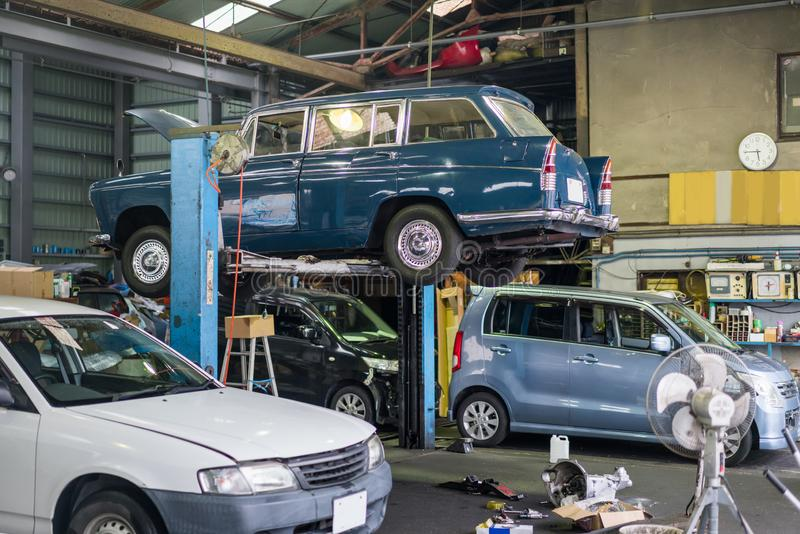 Auto repair service. An auto repair service in Tokyo Japan,car on the jack stock image