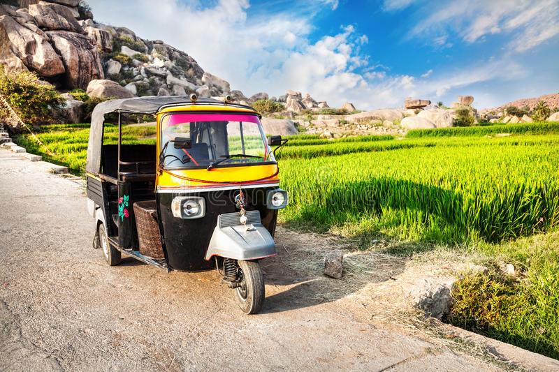 Auto rickshaw near rice plantation royalty free stock image