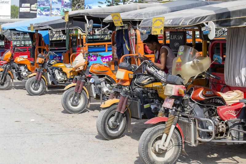 Auto rickshaw, three wheels motorcycle taxi on the street in Myanmar. This transport is cheap and popular in Burma. royalty free stock image