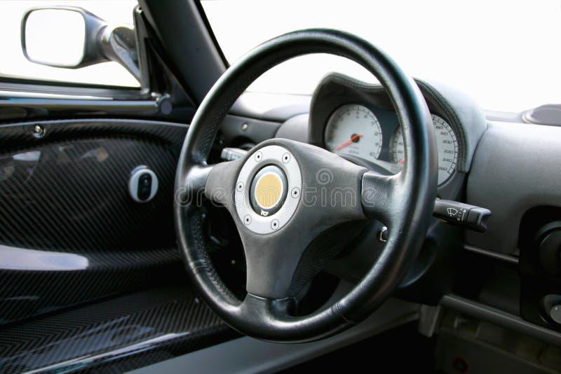 Auto's big black wheel stock photography