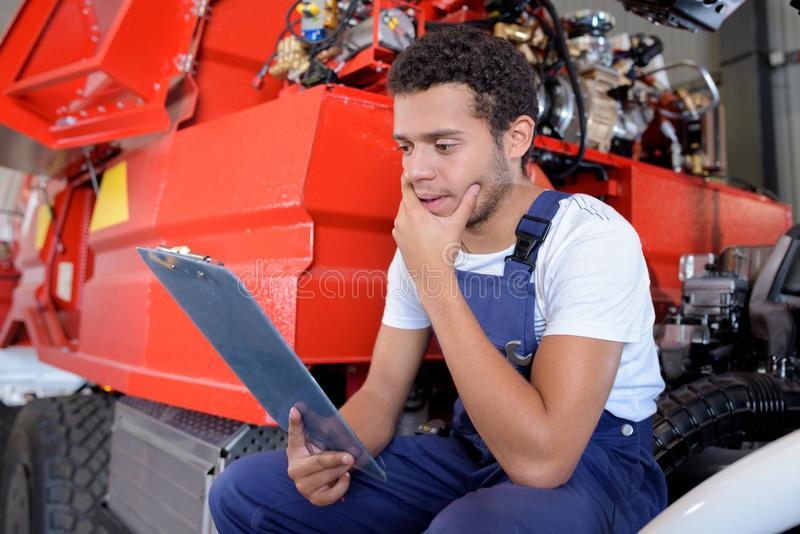 Auto service repair maintenance and people concept. Man stock images