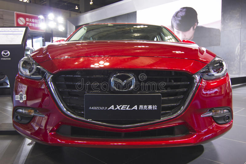 Auto show — Mazda AXELA. The 2017 Chongqing lnternational Auto Consumption Exhibition.Mazda AXELA car front close-up.nPhoto taken April 10, 2017, in royalty free stock photo