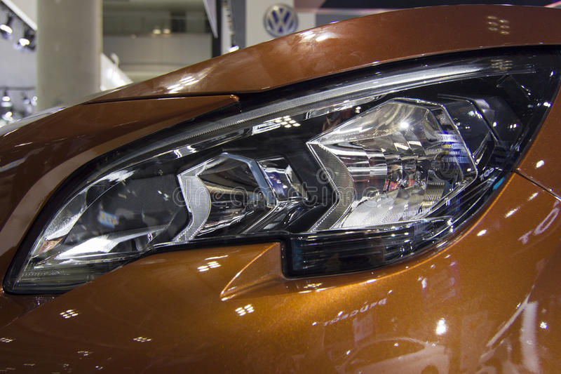 Auto show — Peugeot 4008 headlights close-up. The 2017 Chongqing lnternational Auto Consumption Exhibition,Peugeot 4008 headlights close-up. Photo taken royalty free stock images
