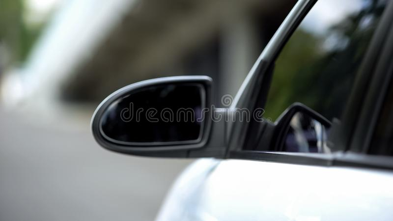 Auto side mirror, road safety, traffic rules, transport purchase, vehicle part. Stock photo royalty free stock image