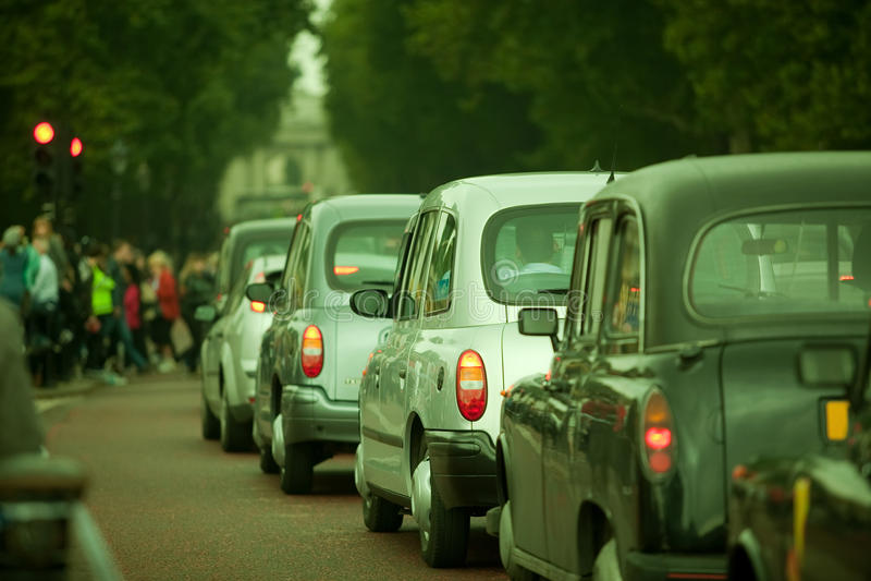 Auto traffic in Lonon City. London auto traffic in Constitution Hill stock photography