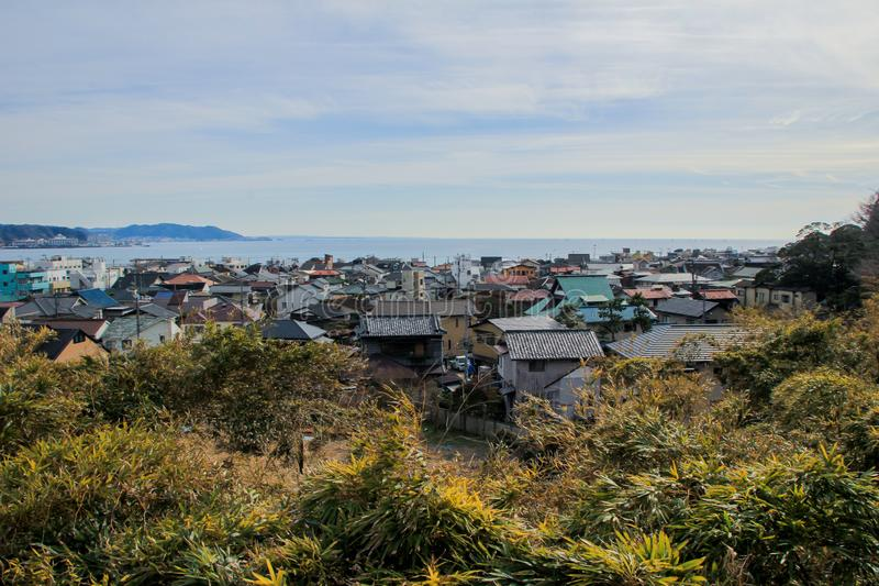 Auto trip around famous places of Japan. Hill view of the bay and town. stock photos