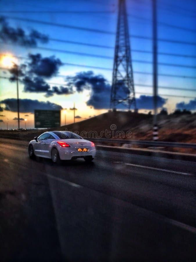 Auto in zon stock afbeelding