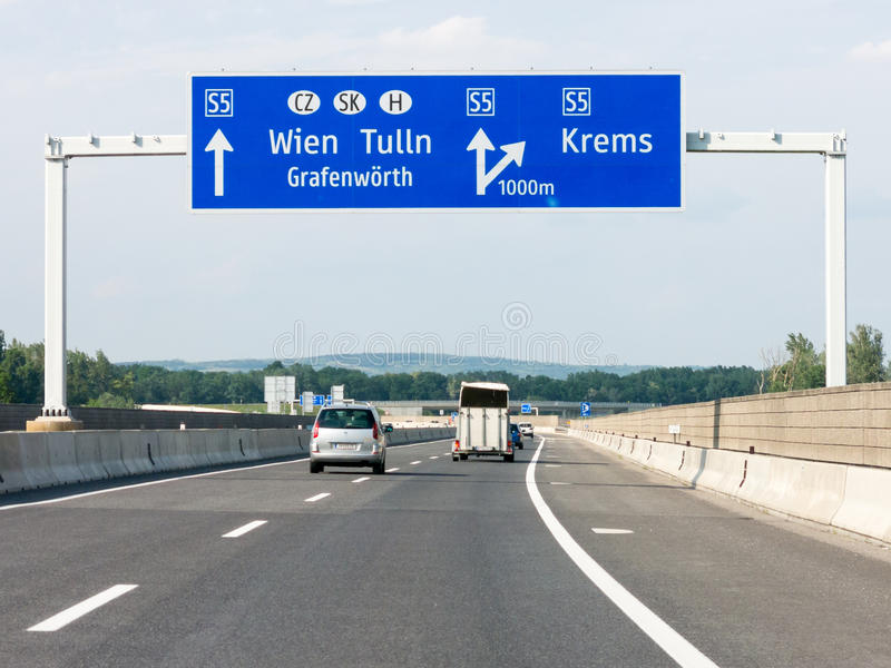 Autobahn S5 with traffic and road sign to Vienna, Austria. Traffic on highway Autobahn S5 and road sign with directions to Vienna, Lower Austria royalty free stock photo