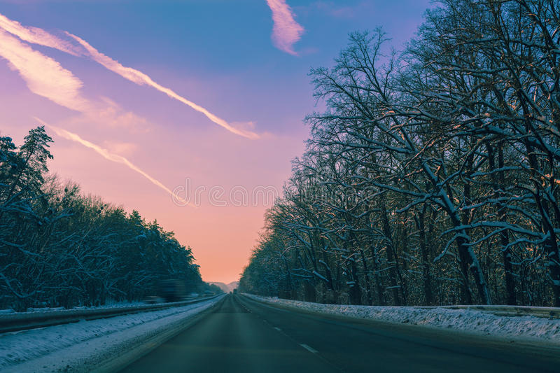 Autobahn in winter. At purple sunset royalty free stock images