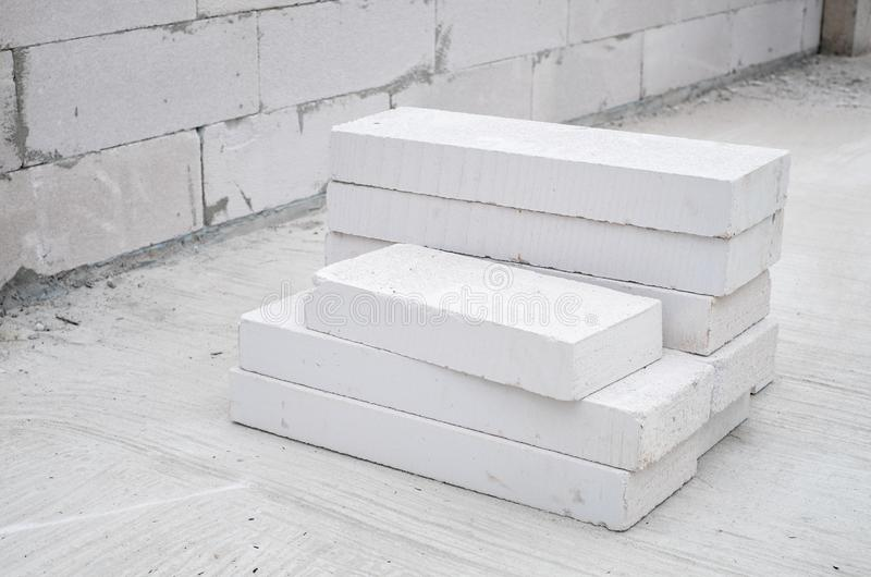 Autoclaved aerated concrete. White autoclaved aerated concrete stack at a construction site stock photo