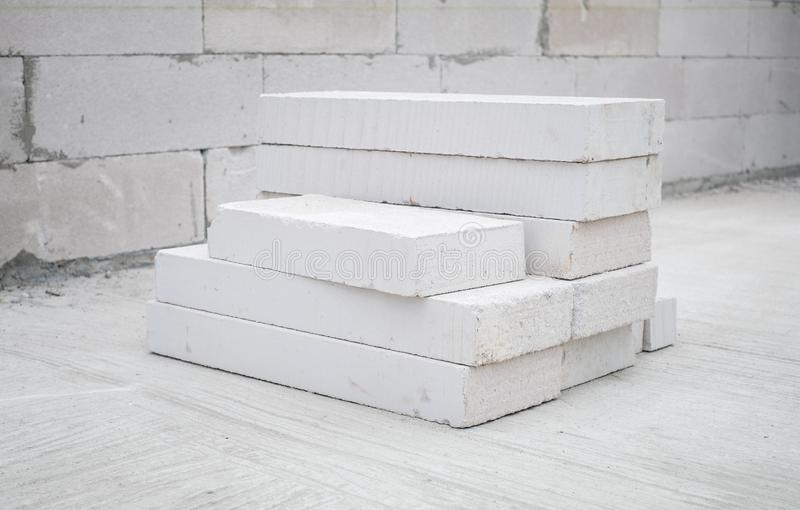 Autoclaved aerated concrete. White autoclaved aerated concrete stack at a construction site stock photography