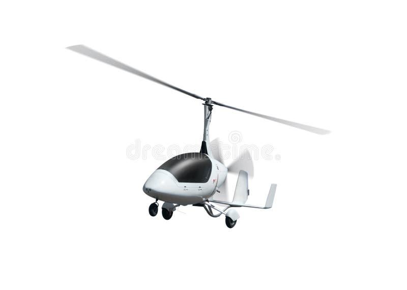 Autogiro i flykten med roterande propellrar fotografering för bildbyråer
