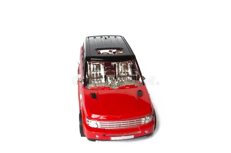 Automóvel de passageiros vermelho em um fundo isolado branco foto de stock