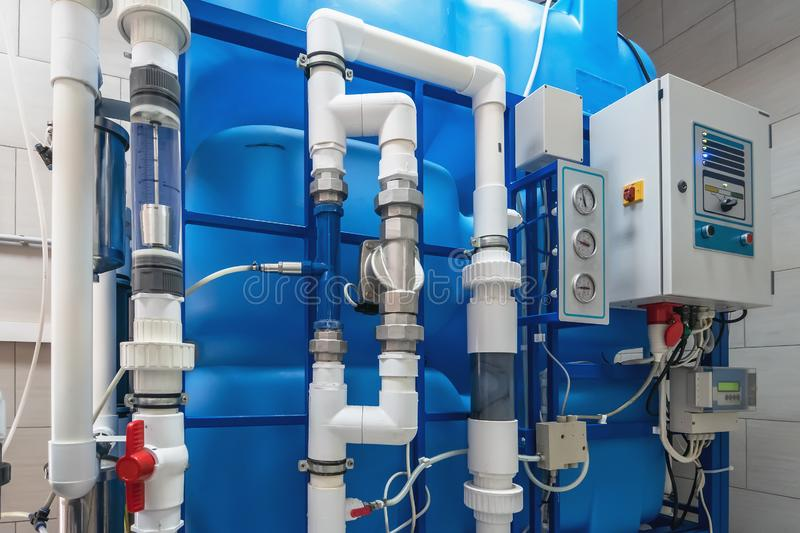 Automated computerized ozone generator machine for ozonation of pure clean drinking water in water production factory. Close up royalty free stock photos
