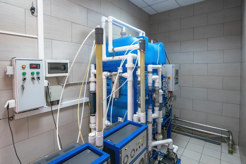 Automated computerized ozone generator machine for ozonation of pure clean drinking water in water production factory. Close up royalty free stock photo