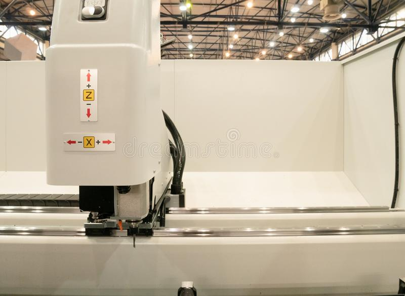 Automated industrial programmable laser cutting engraving machine or 3d printer royalty free stock photo
