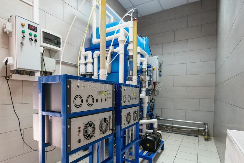 Automated ozone generator for ozonation of pure drinking water in water production factory. Close up royalty free stock images