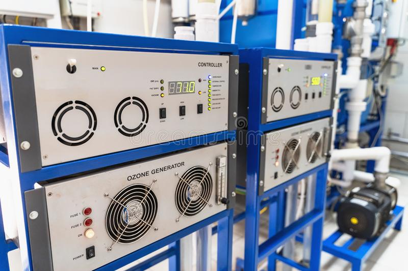 Automated ozone generator for ozonation of pure drinking water in water production factory, close up.  stock photography