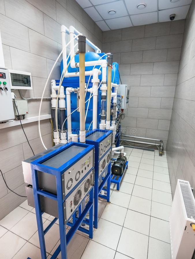 Automated ozone generator for ozonation of pure drinking water in water production factory, close up.  royalty free stock photography