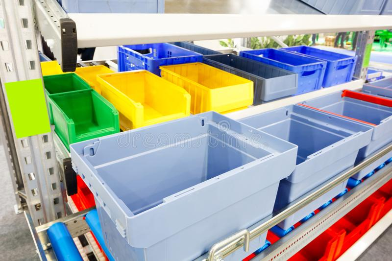 Automated storage warehouse with blue plastic crates.  stock image