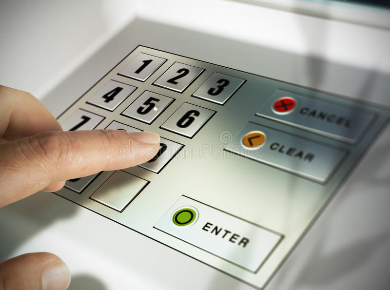 Automated Teller Machine, ATM. Finger about to press a pin code on a pad. Security code on an Automated Teller Machine, ATM royalty free stock photo