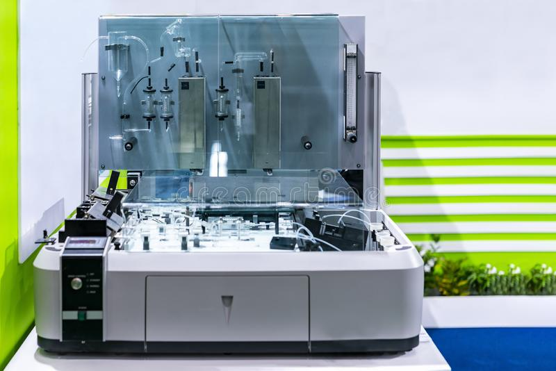 Automated Wet Chemistry Analyzer also known as Continuous Flow Analysis device of lab for stream measurement liquid in tube line. For industrial medical stock photo