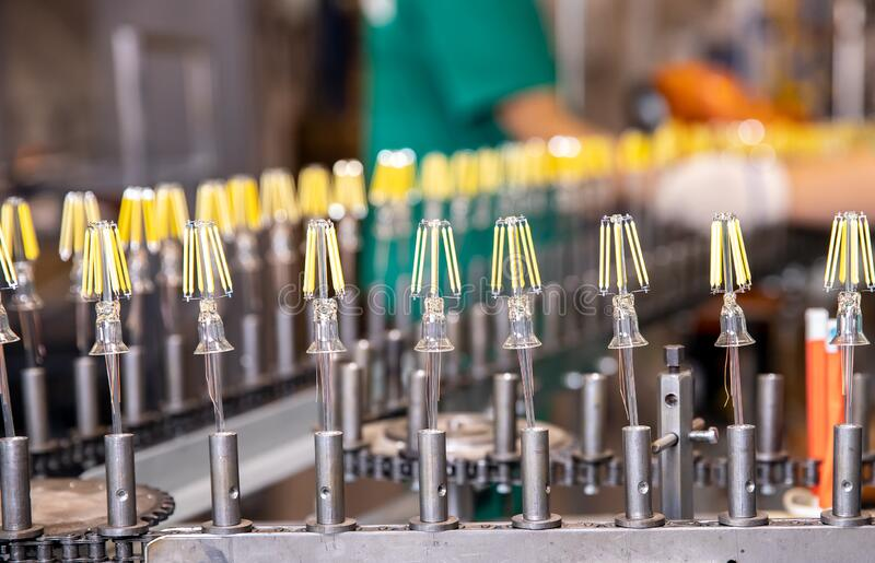 Automated workshop conveyor for production of glass lamps bulbs factory.  royalty free stock photography