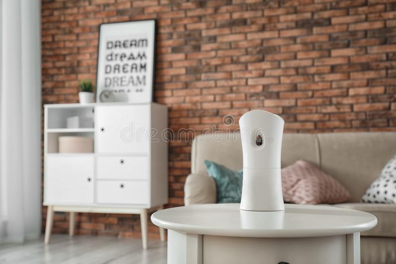 Automatic air freshener on table stock photo