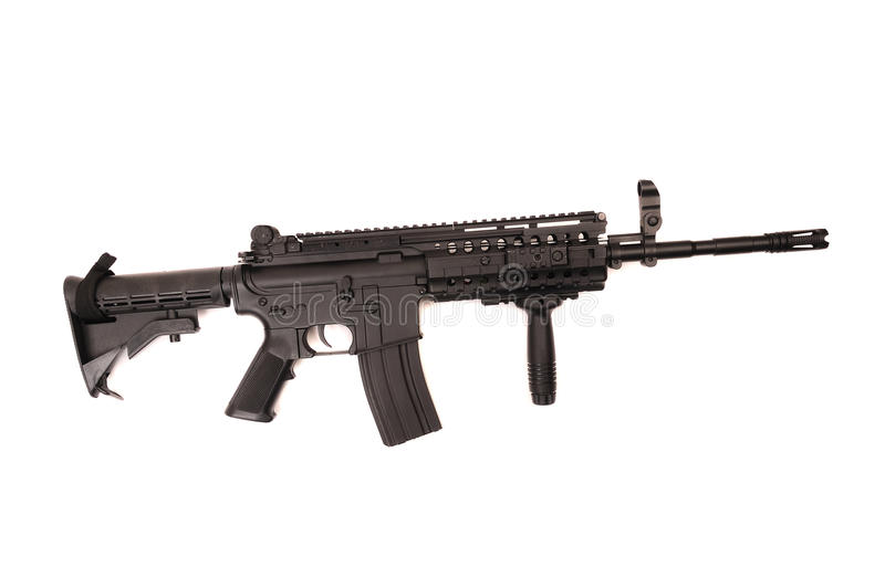 Automatic assault rifle isolated. Full length automatic assault rifle isolated on white stock photography