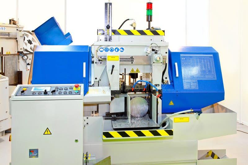 Automatic band saw. Close up shot of automatic band saw machinery stock photo