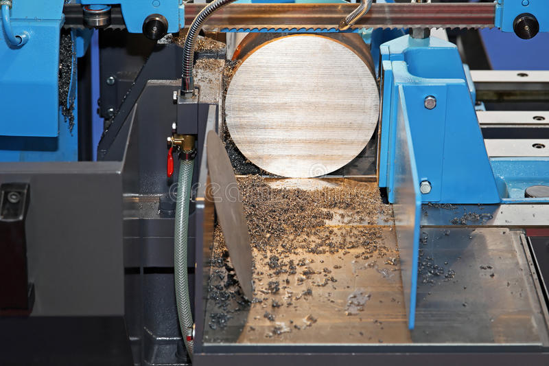Automatic band saw. Automatic metal cutting band saw powerful machine royalty free stock images