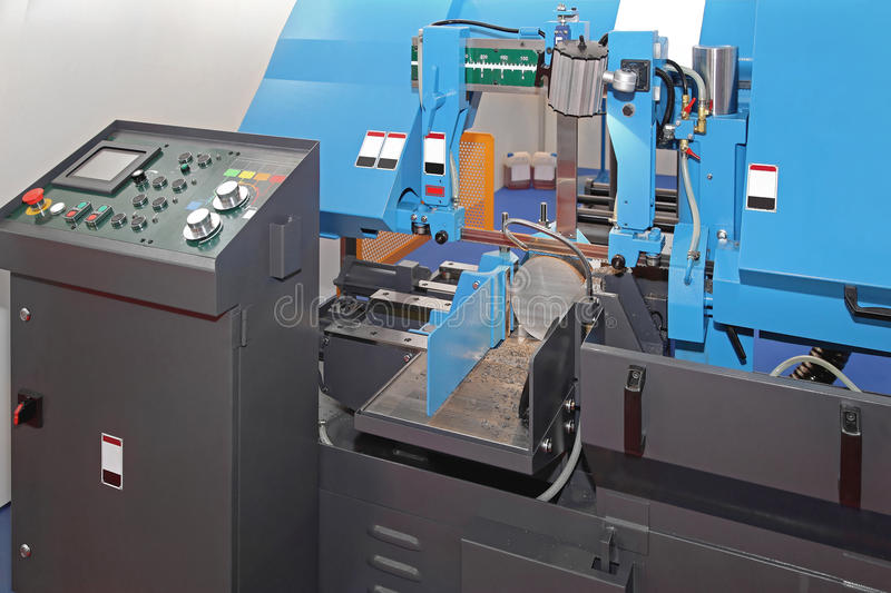 Automatic Band Saw. Automatic Metal Cutting Band Saw Machine royalty free stock photos