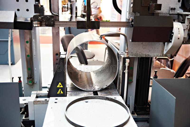 Automatic band saw. With a steel workpiece royalty free stock images