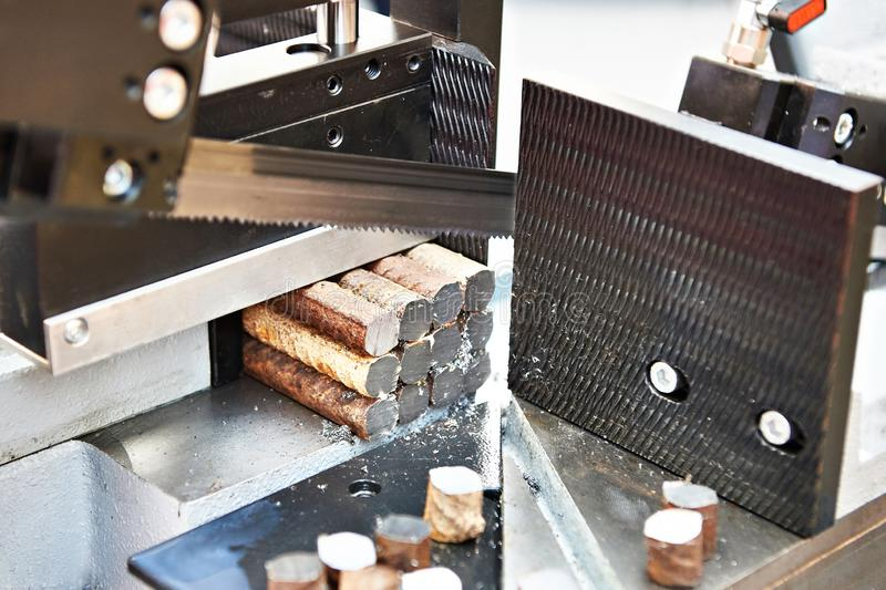 Automatic band saw. With a steel workpiece royalty free stock photo