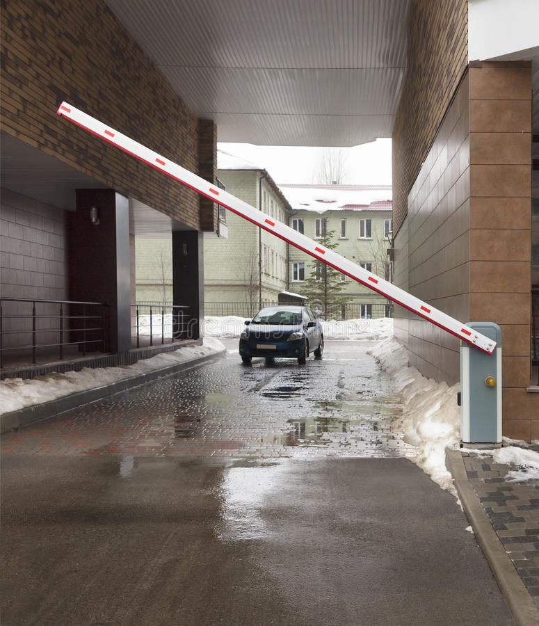 Automatic barrier gates to entry the courtyard of the building stock photos