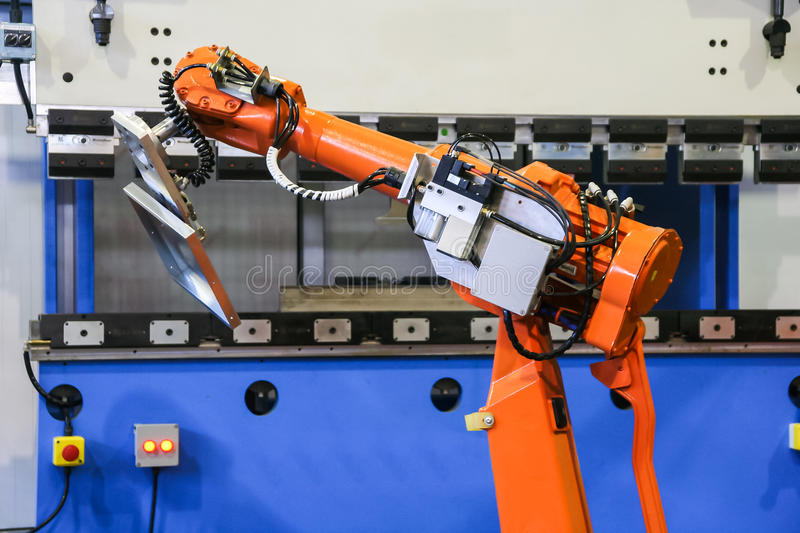 Automatic bending machine with robot. Robot enslavement during bending operation royalty free stock photo