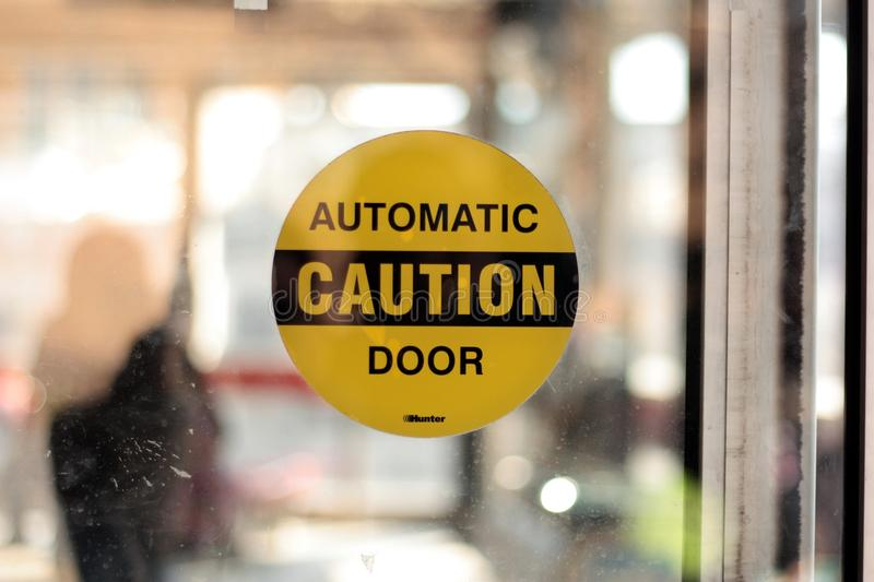 Automatic caution door stock photo image of careful