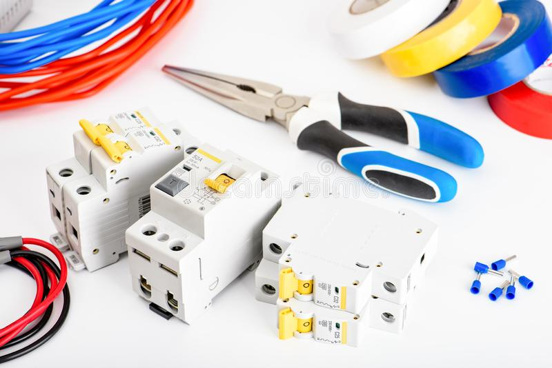 Automatic circuit breakers, copper single core cable. Accessories for safe and secure electrical installation. Electrical royalty free stock image