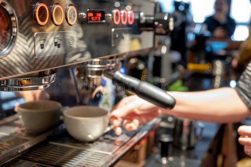 Automatic coffee machine preparing espresso royalty free stock photo