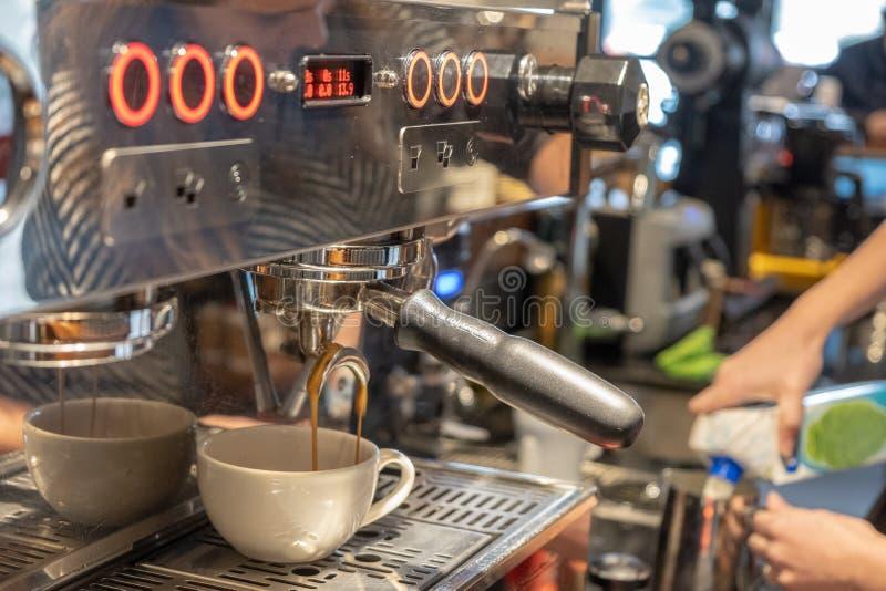 Automatic coffee machine preparing espresso royalty free stock photos