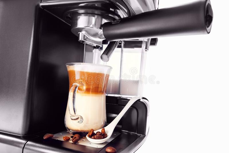 Automatic coffee maker with cup of coffee stock images