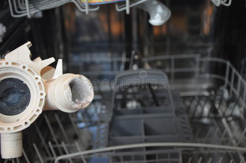 Automatic dish washer  limescale problems. Automatic dish washer machine limescale problems, pipework bricked with limescale restricting water flow royalty free stock photo