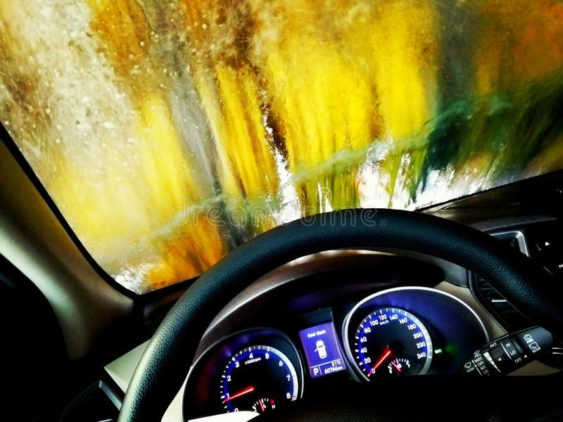 Automatic Drivethrough Carwash In Action Seen Through The Windshield stock image